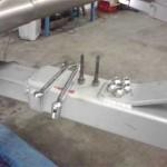 Направляющие шпильки тормозного суппорта, правее лежат колесные гайки